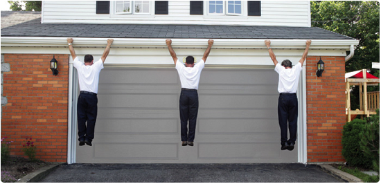 three men hanging on Seamless Guttering to show its strength