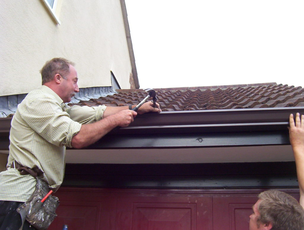 fixing guttering with nail
