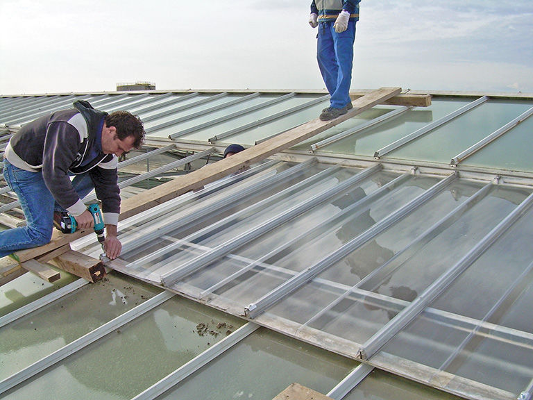 installing a flat roof structure with timber frame
